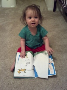 Russell tries to read Hop On Pop at home Friday October 11. After getting frustrated he consumed knowledge by tearing into this classic book.